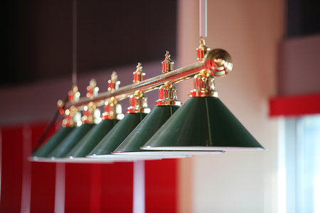 snooker rooms: Row of Billiard green  lamps above table
