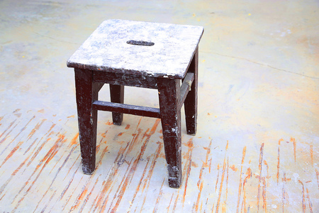 dirty room: Dirty brown stool in the empty  room