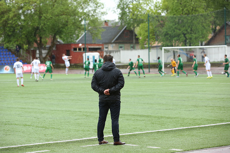 Footbal coach watching the match at rainy time