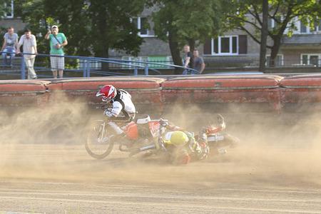 pila: DAUGAVPILS, LATVIA - June 26, 2016: Speedway riders on the track in match of polish NICE league Lokomotiv - Polonia (Pila) 51:39 Editorial