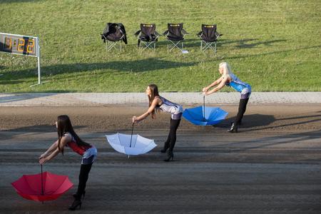 Polonia: DAUGAVPILS, LATVIA - May 22, 2016: Girls for presentation with umbrella in match of polish NICE league Lokomotiv - Wlo?kniarz Cze?stochowa 51:39 Editorial