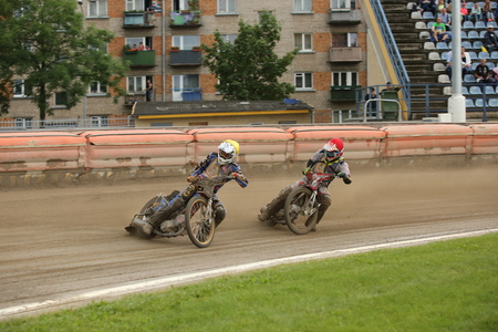 incidence: DAUGAVPILS, LATVIA - July 17, 2016. Speedway riders on the track. Semifinal of Team Speedway Junior European Championship. participants - Latvia, Denmark, Czech, Norway.
