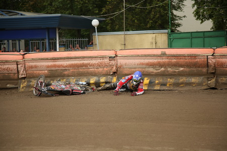 Polonia: DAUGAVPILS, LATVIA - July 17, 2016. Fall down of rider. Semifinal of Team Speedway Junior European Championship. participants - Latvia, Denmark, Czech, Norway.