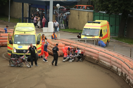incidence: DAUGAVPILS, LATVIA - July 17, 2016. Ambulance try to help rider after fall. Semifinal of Team Speedway Junior European Championship. participants - Latvia, Denmark, Czech, Norway. Editorial