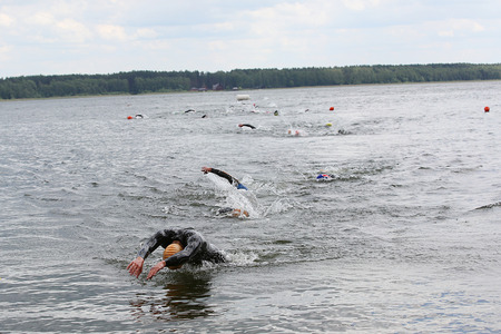 Group of Swimming athletes in a triathlon contest