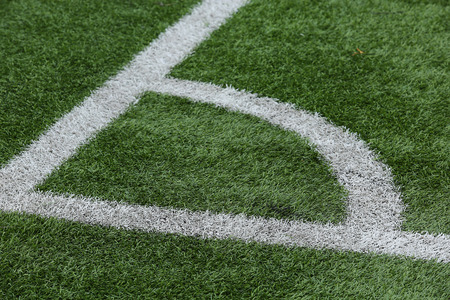 linesman: Close-up of a football field corner on artificial turf Stock Photo