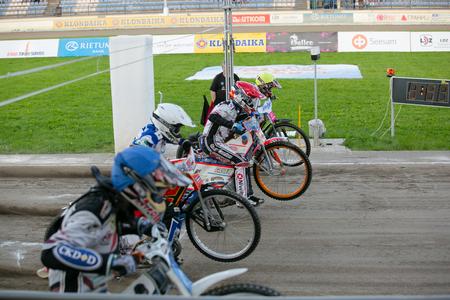 Polonia: DAUGAVPILS, LATVIA - August 21, 2016: Episode from match of polish NICE league Lokomotiv - Wanda Instal Krakow 54:35. Speedway riders on the start