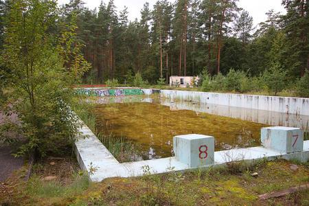 Abandoned outdoor 50 meter swimming pool in Daugavpils Editorial