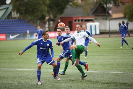 DAUGAVPILS, LATVIA - September 18, 2016: game episode in a football match with contact. Latvian championship, high league. BFC Daugavpils - MettaLU 3:3