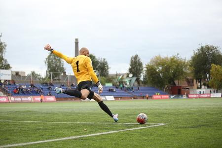 DAUGAVPILS, LATVIA - September 18, 2016: Goalkeeper kick out the ball. game episode in a football match with contact. Latvian championship, high league. BFC Daugavpils - MettaLU 3:3