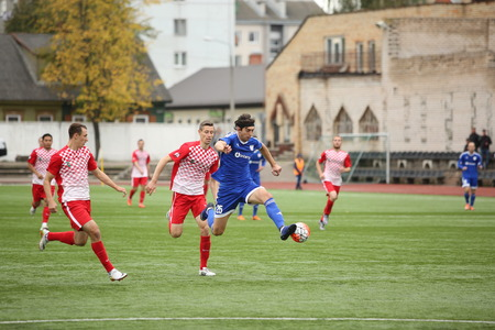 DAUGAVPILS, LATVIA - September 24, 2016: game episode in a football match with contact. Latvian championship, high league. BFC Daugavpils - FC Spartak 1:0