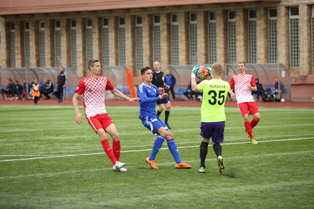 episode: DAUGAVPILS, LATVIA - September 24, 2016: game episode in a football match with contact. Latvian championship, high league. BFC Daugavpils - FC Spartak 1:0