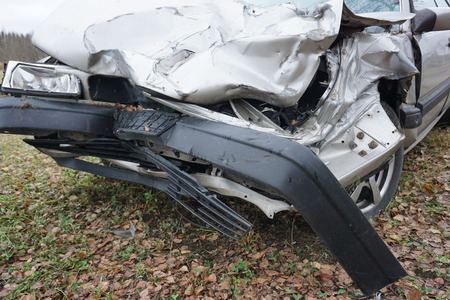 dint: car accident and wrecked car on the road