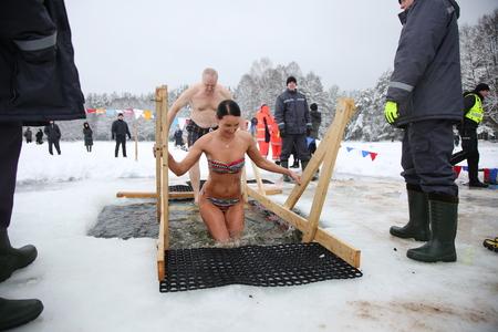 DAUGAVPILS, LATVIA - January 19, 2017: Orthodox church Holy Epiphany Day. People bathed in the ice-hole on Epiphany