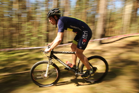 DAUGAVPILS, LATVIA - May 6, 2016: Daugavpils Cup - 2017. Race Cyclo-cross. Cyclist competes in the elite MTB race at forest.
