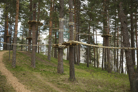 Hanging trails in the adventure park. Obstacle course Stock Photo