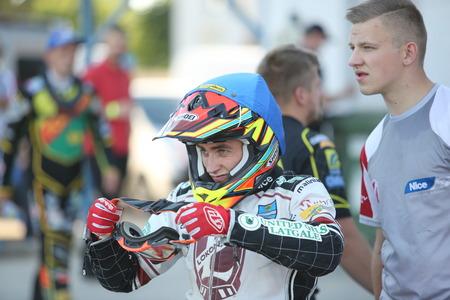 pila: DAUGAVPILS, LATVIA -June 17, 2017: Match of polish NICE league Lokomotiv - Pila. Rider Jevgenijs Kostigovs