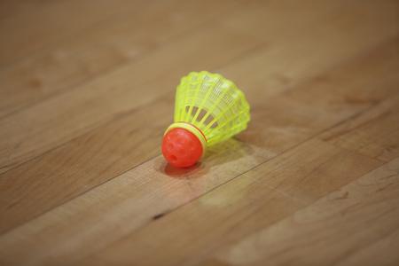 speedminton shuttlecock on the floor with wooden texture
