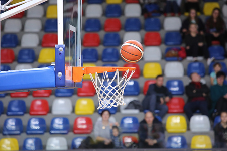 The ball is flying in the basket. Basketball