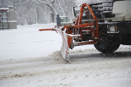 Snowplow removing snow from city road at winter time Reklamní fotografie