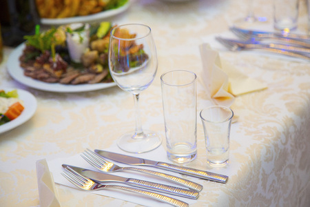 Table setting in a restaurant. Cutlery and glasses