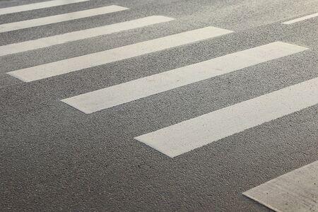 crosswalk on asphalt texture background. pedestrian crossing