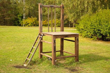KRASLAVA, LATVIA - September 5, 2018 Big wooden chair on the meadow in Kraslava Editorial