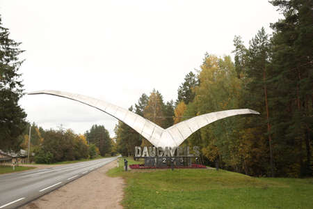 DAUGAVPILS, LATVIA - October 4, 2019 Sign at the entrance to the city Daugavpils. Silver metal gull