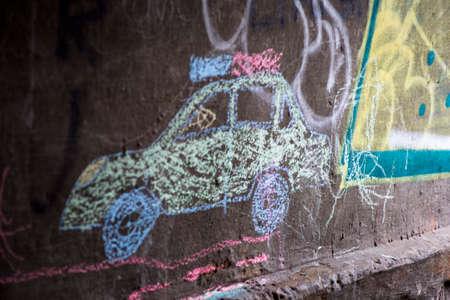 Chalked police car on the grey wall