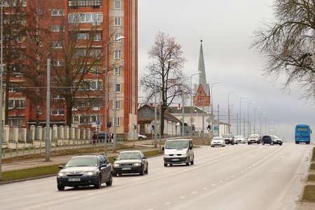 DAUGAVPILS, LATVIA - February 12, 2020 Cenraal street 18 November of Daugavpils. 19th-century church in the background
