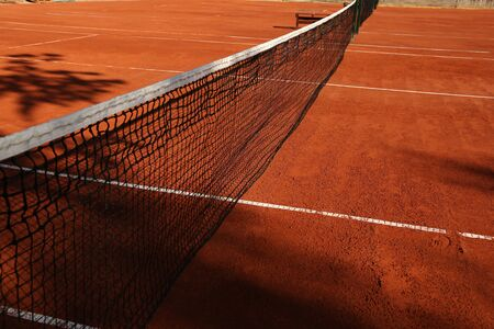 net on ground court on day light with shadow Imagens