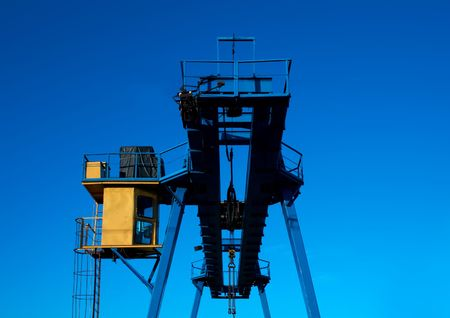 crane against a backdrop of blue sky photo