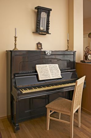 old room with a piano and the clock photo