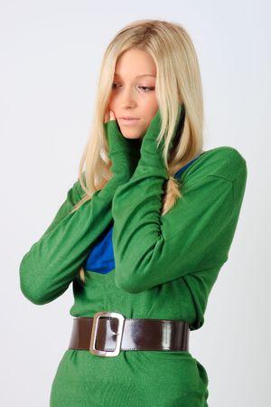 tunic: Young girl in a green tunic posing