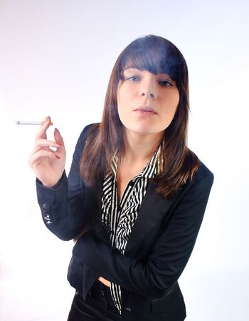 Woman in a suit smoking a cigarette photo