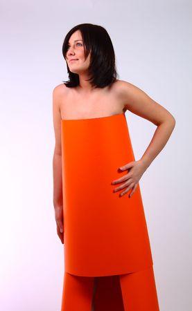 Woman in paper orange dress photo