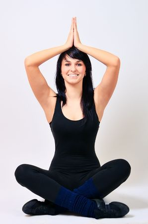 Young girl in lotus position photo