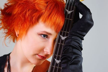 Young girl with a guitar Stock Photo - 6666379