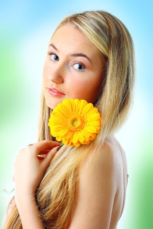 Young woman with a flower. Over white background photo