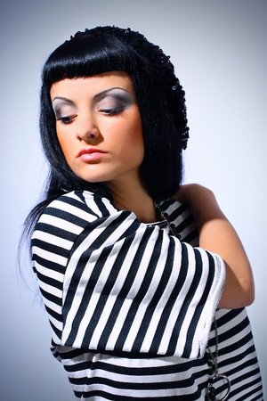Attractive fashion woman posing in a striped top Stock Photo - 7034855