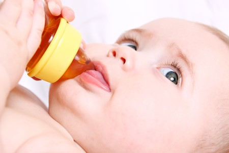Baby drinking from a bottle photo