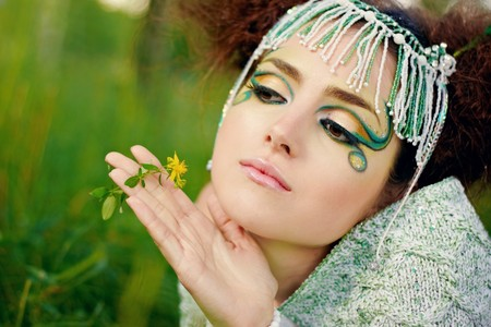 The portrait of a woman, fantasy make-up photo
