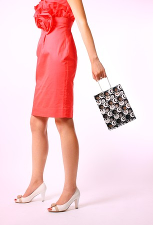 Woman with shopping bag on a white background photo