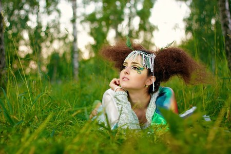 Young girl in forest, fantasy make-up photo