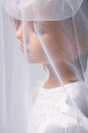 The little girl in a dress of the bride, studio shot photo