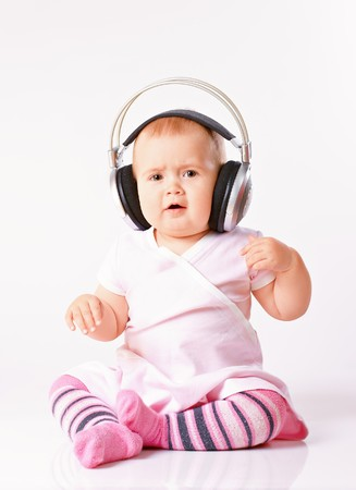 Portrait of young baby girl listening music