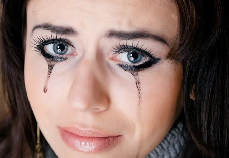 Crying woman towards white background photo