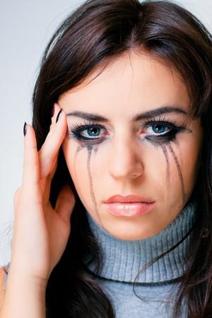 Crying woman towards white background photo