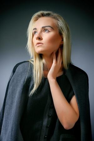 Beautiful model posing on grey background photo