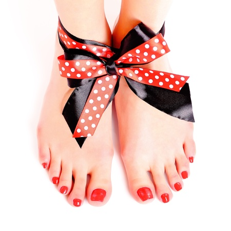 Legs with a bow on white background